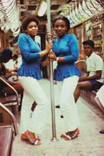 Jameel Shabazz, Two women in blue on the subway, 1980-1989, featured in Flava
