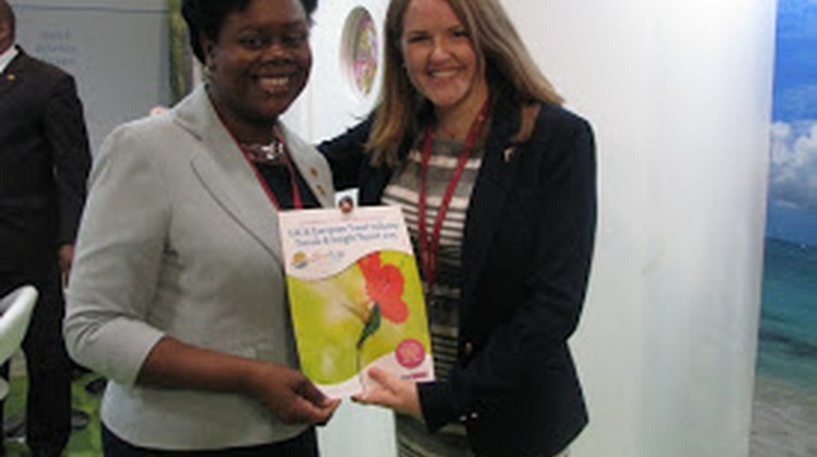 CTO's director of marketing for UK/Europe Carol Hay receives a copy of CTO's UK/Europe Travel Industry Trends and Insights Report 2015 from Pippa Jacks of TTG.