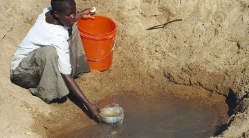 In Meatu district, Tanzania (Africa), water most often comes from open holes  dug in the sand of dry riverbeds, and it is invariably contaminated. Photo: Bob Metcalf